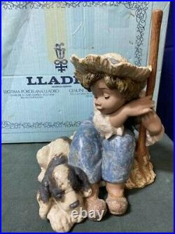Collectible vintage porcelain figurines Lladro #2208 Let's Rest Boy withhis dog