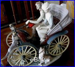 Delightful LLADRO Couple in Horseless Carriage with Dogs