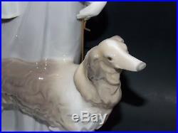 Figurine sculpture lladro lady with dog girl dog lladro. 4594