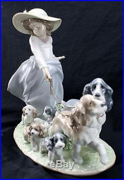 LLADRO Privilege Porcelain Girl with Walking Dogs and Puppies
