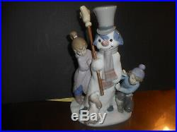LLadro snowman with children and dog