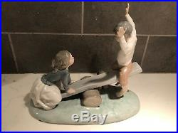 Lladro 4867 BOY AND GIRL ON SEE SAW WITH DOG