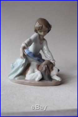 Lladro 5688'Dog's Best Friend' figurine Girl covering Dog with blanket