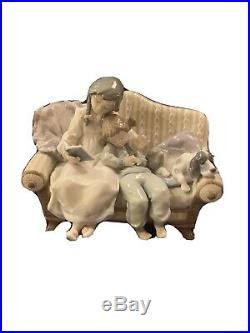 Lladro 5735 girl reading to child with dog on the couch. MINT CONDITION