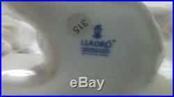 Lladro 6337 Poodle puppy dog laying down with pink collar bow no box