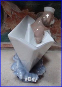 Lladro #6642 Little Stowaway dog w sailor hat asea in a paper boat- MIB, RV$210