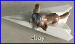 Lladro 6665 Let's Fly Away goggled puppy dog on a paper airplane MWOB, RV$210
