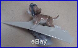 Lladro #6665 Let's Fly Away puppy dog in a paper airplane MINT, no box, RV$210