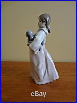 Lladro Arms Full of Love Girl withTwo Dogs Figurine # 6419