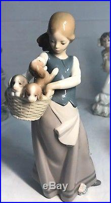Lladro Figurine #1311 Little Dogs On Hip Girl With a Basket Full Of Puppies