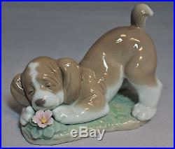 Lladro Figurine, 6832 A Sweet Smell, Dog with Flower, 4.25H $250 V
