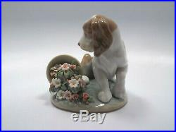 Lladro Figurine #7672 It Wasn't Me, Puppy Dog with Flowers, with box