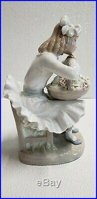 Lladro Girl Sitting in Chair with Flower Basket and Dog Porcelain Figurine