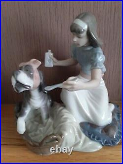 Lladro. Girl giving her dog medication Take your medication No. 5921