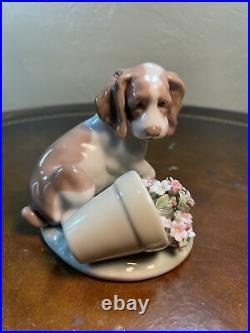 Lladro It Wasnt Me dog and flowers