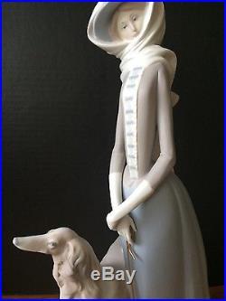 Lladro Lady Walking Dog Figurine