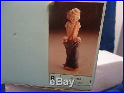 Lladro Little Pals, boy/clown w dogs in pockets #7600 Collector Soc, 9 mint