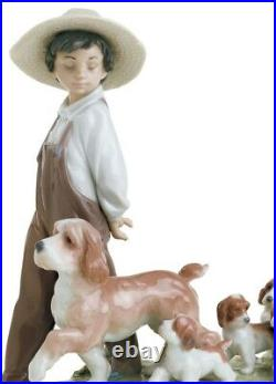 Lladro My Little Explorers Boy with Dogs Figurine