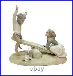 Lladro Spain Porcelain Seesaw Figurine Matte #4867. Girl, Boy, and Dog