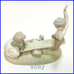 Lladro Spain Porcelain Seesaw Figurine Matte #4867. Girl, Boy, and Dog