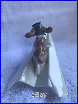 Lladro dog #6665 with box and certificate lets fly away