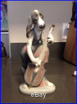 Lladro dog playing bass fiddle