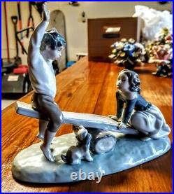 Lladro figurine Beautiful scene boy and girl on seesaw with dog beside them