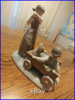 Lladro figurine girl with dog in cart. No flaws no box