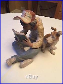 Lladro figurine of Boy and dog reading Tom Sawyer Item no 2238 18cm high x 20cm