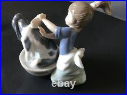 Lladro girl washing her dog 5 in. Tall perfect condition
