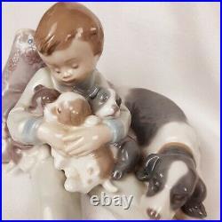Llardo Porcelain Figurine 1987 Sleeping Boy with Dog Puppies 7 x 6.5 x 3.5