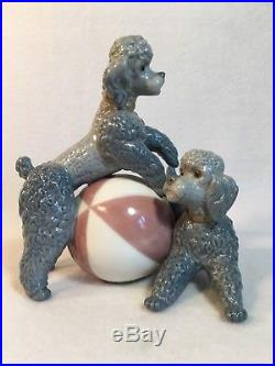 Retired Lladro Playful Dogs #01001258 Glazed Poodles withRed & White Ball