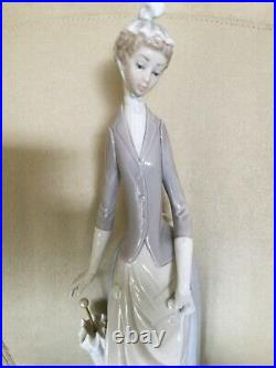 Retired Lladro figurine. Lady with umbrella and dog