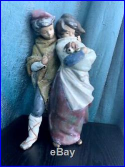 Vintage Lladro Boy And Girl Holding a Dog, 14 tall